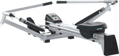 Гребной тренажер 7977-900 KadettГребные<br>Специальная конструкция данного тренажера позволяет идеально имитировать греблю. Система нагружения: 2 гидравлических цилиндра. Независимое нагружение для каждой руки.
